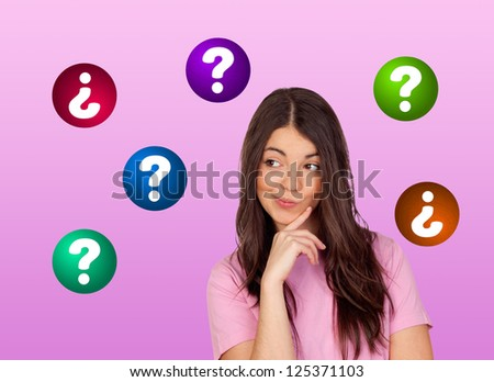 Doubtful brunette girl isolated on a pink background