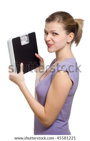 doubtful young woman holding a weight scale over white background