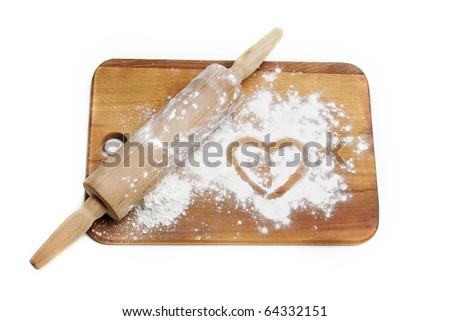 dough roller and flour over white