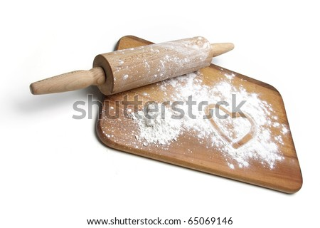 dough roller, board and flour over white