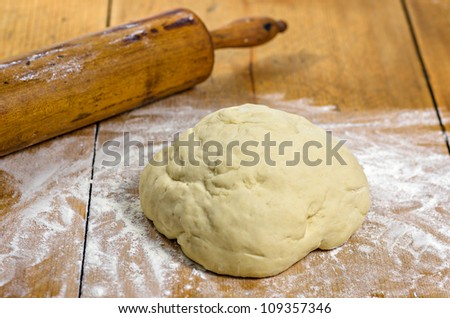 dough with rolling pin - stock photo