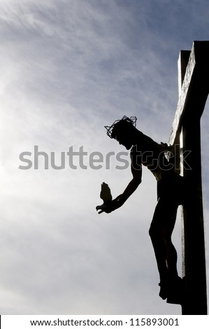Dove of peace being released by Jesus as he hangs on the cross.