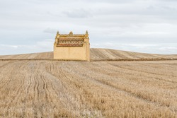 Dovecote and harvested cereal fields.