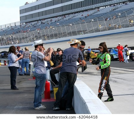 DOVER, DE - SEPTEMBER 25: Danica Patrick walks on pit road to car for qualifying for the NASCAR Nationwide Series race on Saturday, September 25, 2010 in Dover, DE.