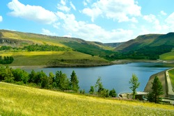 Dovestone Reservoir lies at the convergence of the valleys of the Greenfield and Chew Brooks above the village of Greenfield, on Saddleworth Moor in Greater Manchester