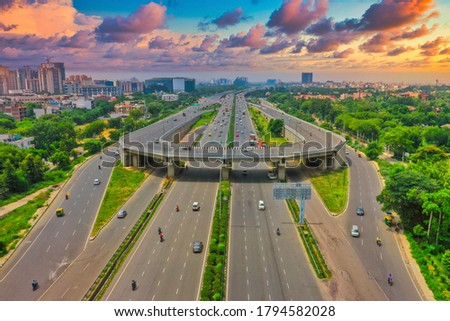 Down aerial view of empty roads near, Gurgaon city