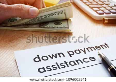 Down payment assistance form and dollar banknotes. #1096002341