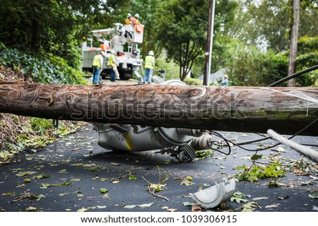 Down power lines and electric equipment in residential neighborhood