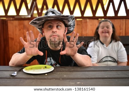 Down syndrome couple in barbecue party