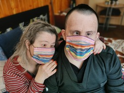 down syndrome couple with respirator mask. Danger  covid19