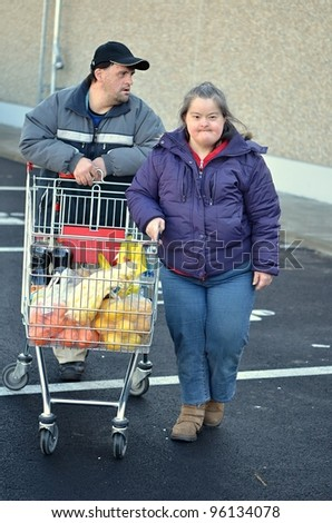 down syndrome couple with shopping cart
