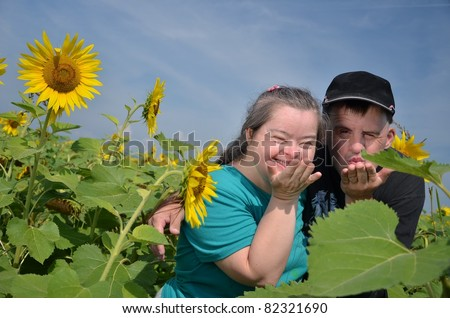 down syndrome couple with sunflower