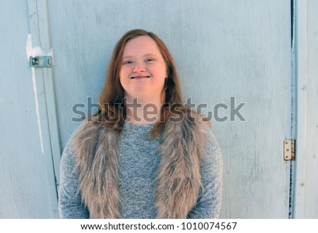 Down syndrome girl outside on snowy day