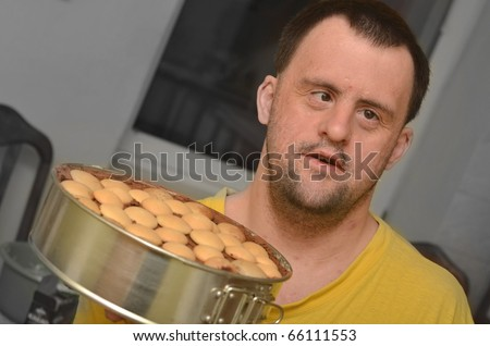 down syndrome man in his kitchen