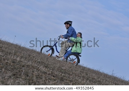 Down syndrome stock photos: love in bike