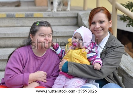 down syndrome woman with baby