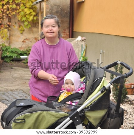 down syndrome woman with baby in stroller