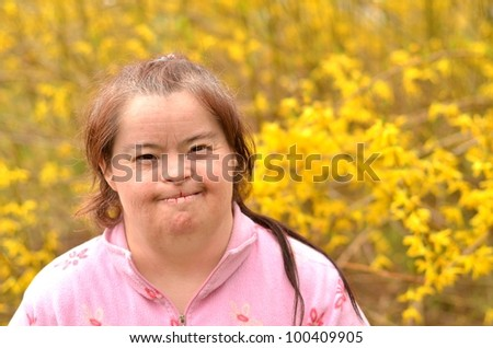down syndrome woman with golden rain flowers