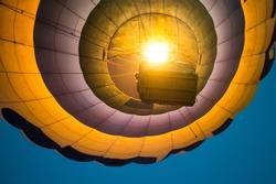Down view on hot air balloon flying. closeup