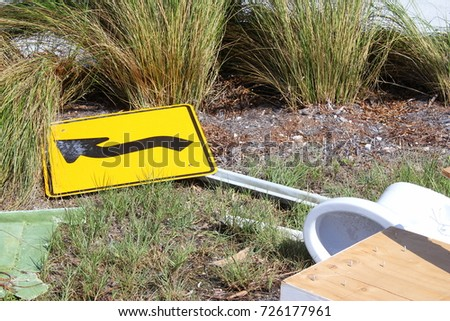 Downed curving road sign in the streets aftermath of Hurricane Irma flooding and tidal wave in Islamorada in the florida Keys #726177961