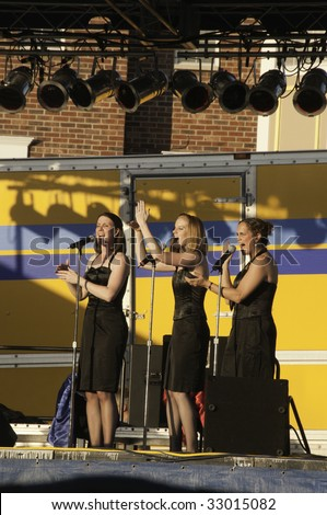DOWNERS GROVE, IL - JUNE 26: Chicago-based female quartet Route 66 performs a golden oldie (with one singer off camera) on stage during Heritage Festival June 26, 2009 in Downers Grove, IL.