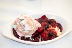 DOWNERS GROVE, ILLINOIS / USA - AUGUST 31, 2017: Delicious serving of a berry and ice cream dessert.