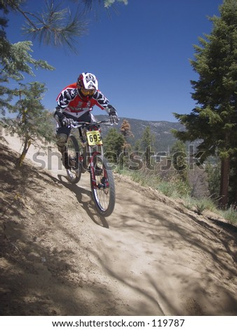 Downhill mountain bike race - stock photo