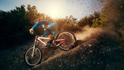 Downhill mountain bike. Young man cyclist to riding a bicycle.