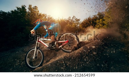 Downhill mountain bike. Young man cyclist to riding a bicycle.