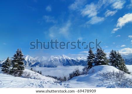 downhill ski slope at sunny winter day