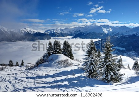 downhill ski slope at sunny winter day in the mountains