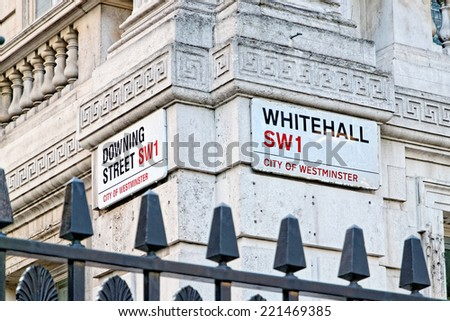 Downing Street\'s sign in Westminster. Downing St. has housed government leaders for over three hundred years.