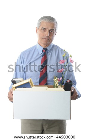 Downsized Middle Aged Businessman carrying a box of personal belongings isolated on white vertical format