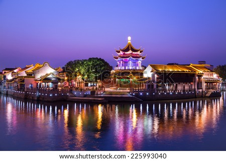 Downtown area of a Chinese city, Suzhou, in China,  at blue hour.  The city has a nick name:  paradise on earth.
