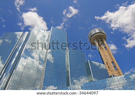 Downtown buildings against cloudy sky