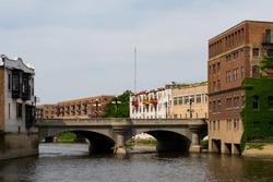 Downtown buildings on the Fox River.  Aurora, Illinois, USA