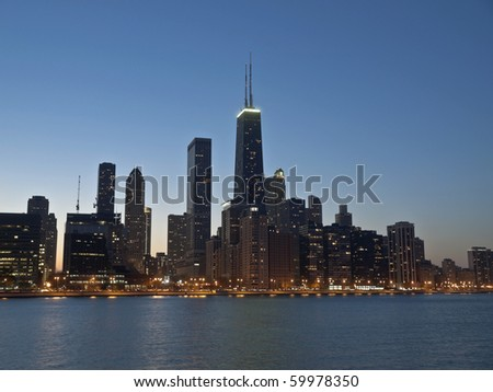 Downtown Chicago and the Lake Michigan shore at night.