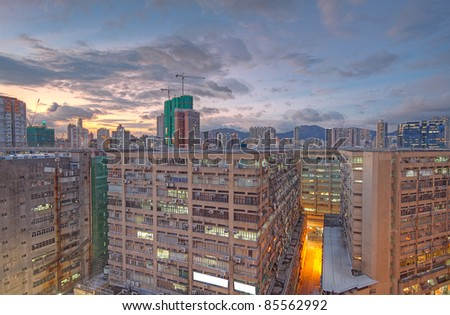 downtown city and old building in sunset - stock photo