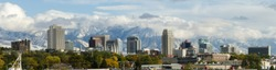 Downtown city skyline of Salt Lake City, Utah,  the Wasatch mountains in the background in autumn
