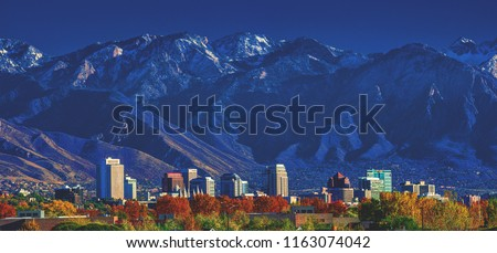 Downtown city skyline of Salt Lake City, Utah, with the Wasatch mountains in the background in afternoon sunshine. #1163074042