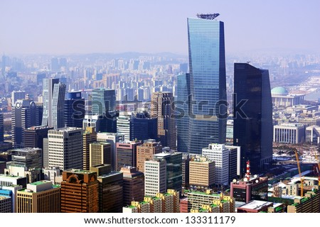 Downtown cityscape of Seoul, South Korea on a smoggy day.