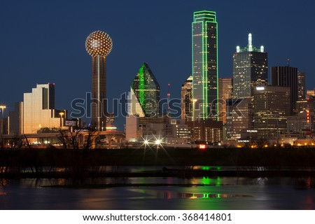 Downtown Dallas, Texas at night with the Trinity River in the foreground stock photo