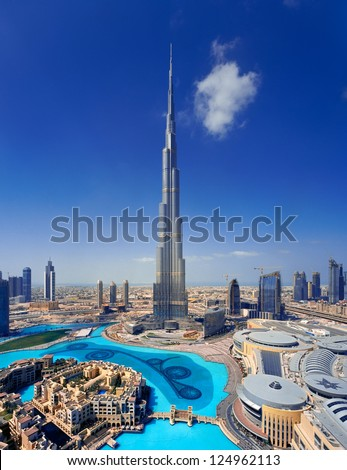 DOWNTOWN DUBAI, UAE - MAY 7 - A skyline view Dubai Mall, Dubai Fountain and the Burj Khalifa, the tallest skyscraper in the world, at 829.8 m.   on May 7, 2010. - stock photo