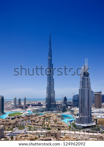 DOWNTOWN DUBAI, UAE - MAY 7 - A skyline view showing the Burj Khalifa, the tallest skyscraper in the world, at 829.8 m and the 63-storey, 302.2 m Address Hotel.   on May 7, 2010.