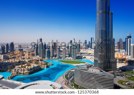 DOWNTOWN DUBAI, UAE - MAY 7 - The Dubai Fountain is set on the 30-acre manmade Burj Khalifa Lake. Lit by 6600 lights and 50 projectors it shoots water 150 m into the air. Picture taken on May 7, 2010.