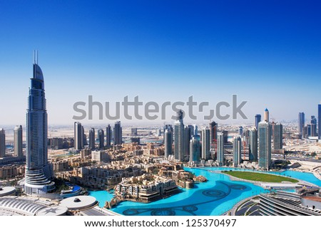 DOWNTOWN DUBAI, UAE - MAY 7 - The Dubai Fountain is set on the 30-acre manmade Burj Khalifa Lake. 63-storey, 302.2 m Address Hotel is visible on the left. Picture taken on May 7, 2010.