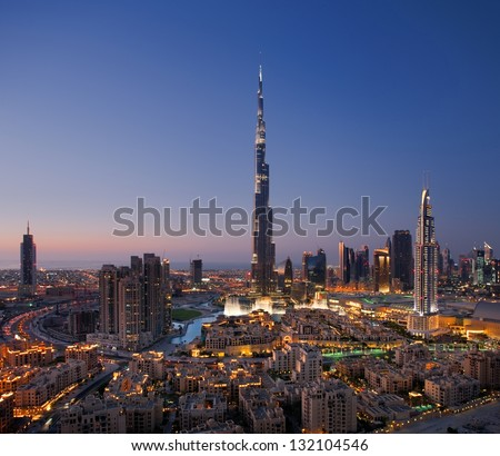 DOWNTOWN DUBAI, UAE - OCT 15: Skyline view of Downtown Dubai showing the Burj Khalifa and Dubai Fountain on Oct 15, 2010 in Dubai, UAE. The Burj Khalifa, the tallest skyscraper in the world at 829.8m