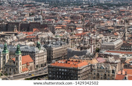 Downtown (Ferenciek square) of Budapest, Hungary from above. Rooftop view with buildings, towers and colorful rooftops. European capital city skyline. #1429342502