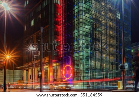 Downtown financial district setting with passing cars as light trails #551184559