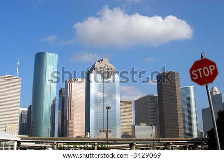 Downtown Houston and stop sign - stock photo